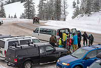Backcountry skiers and snowboarders offload a free shuttle Saturday at the top of Teton Pass, a trial by the Teton Backcountry Alliance as part of finding solutions to congested parking at the popular summit parking area.