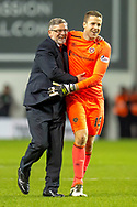 Craig Levein, manager of Heart of Midlothian and Colin Doyle (#13) of Heart of Midlothian celebrate at the final whistle of the Ladbrokes Scottish Premiership match between Hibernian FC and Heart of Midlothian FC at Easter Road Stadium, Edinburgh, Scotland on 29 December 2018.