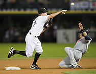 CHICAGO - JUNE 05:  Chris Getz #17 of the Chicago White Sox turns a double play over the sliding Shin-soo Choo #17 of the Cleveland Indians on June 5, 2009 at U.S. Cellular Field in Chicago, Illinois.  The Indians defeated the White Sox 6-0.  (Photo by Ron Vesely)