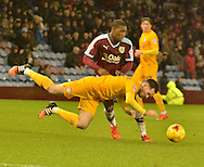 Burnley Defender, Tendayi Darikwa tries to get through a flying Preston North End Defender, Greg Cunningham during the Sky Bet Championship match between Burnley and Preston North End at Turf Moor, Burnley, England on 5 December 2015. Photo by Mark Pollitt.
