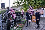 Merrick, New York, USA. September 11, 2015. A Merrick and NYC firefighter place a wreath in memory of Ex-Chief Ronnie E. Gies at Merrick Memorial Ceremony for Merrick volunteer firefighters and residents who died due to 9/11 terrorist attack at NYC Twin Towers. Gies, of Merrick F.D. and FDNY Squad 288, and Ex-Captain Brian E. Sweeney, of Merrick F.D. and FDNY Rescue 1, died responding to the attacks on September 11, 2001.