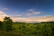 Moon and star light highlight the gentle rolling hills of the country side along the Kanawha River Valley in Henderson, West Virginia.