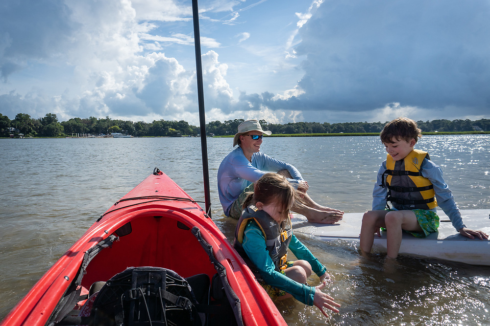 Michael, Sam and Eleanor swim on an emerging sand bar as the tide falls in the May River near Bluffton Oyster Co.