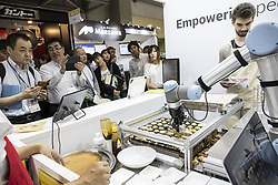 June 15, 2018 - Tokyo, Japan - Visitors look at the latest technology products for food processing during the International Food Machinery and Technology Exhibition (FOOMA JAPAN) in Tokyo Big Sight, Tokyo, Japan. The annual exhibition introduces 798 companies' latest products and services for food processing industry distributed in 8 halls of Tokyo Big Sight. FOOMA JAPAN runs from June 12 to 15. (Credit Image: © Rodrigo Reyes Marin/via ZUMA Wire via ZUMA Wire)