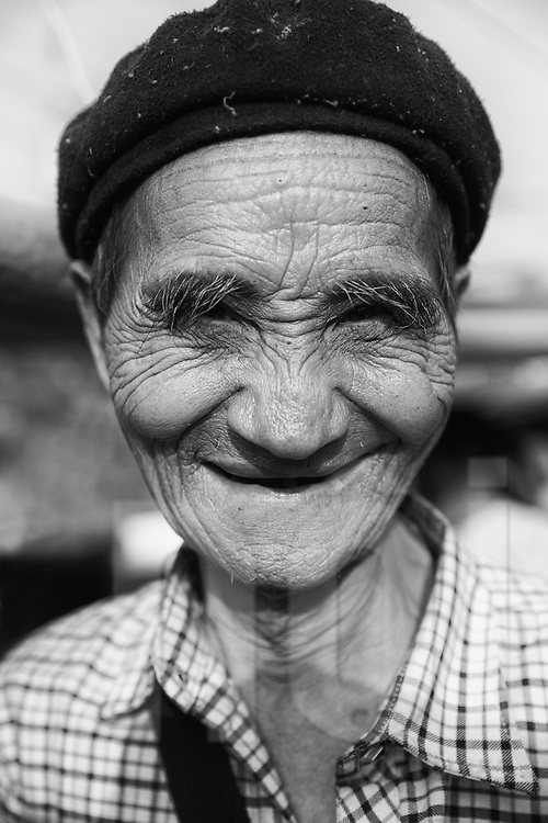 Soulful portrait of an old vietnamese man wearing a beret, Dong Van, Ha Giang Province, Vietnam, Southeast Asia