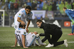 October 8, 2018 - Seattle, Washington, U.S - Seattle's NICO LODEIRO (10) gets some attention from the Sounders training staff after knocking knees with CRISTIAN ROLDAN (7) as the Houston Dynamo visits the Seattle Sounders in a MLS match at Century Link Field in Seattle, WA. (Credit Image: © Jeff Halstead/ZUMA Wire)