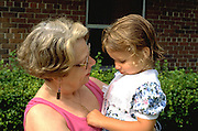 Grandma holding and talking to granddaughter age 55 and 4.  Beaver Dam Wisconsin USA