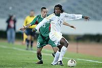 Fotball<br /> African Nations Cup 2004<br /> Afrika Mesterskapet<br /> Foto: Digitalsport<br /> Norway Only<br /> <br /> FIRST ROUND - GROUP D - 040204<br /> MOROCCO v SOUTH AFRICA<br /> MAROKKO v SØR AFRIKA<br /> <br /> THABANG MOLEFE (RSA) / HOUCINE KHARJA (MOR)