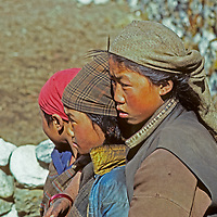 Sherpa girls watch intently as village life goes on in Namche Bazaar, the leading town of Nepal's Khumbu region.