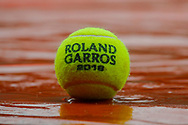 Tennis ball illustration under rain on the playground during the Roland Garros French Tennis Open 2018, day 11, on June 6, 2018, at the Roland Garros Stadium in Paris, France - Photo Stephane Allaman / ProSportsImages / DPPI