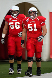 24 September 2011: Cody White and Cal McCarthy exits the player tunnel before an NCAA football game between the South Dakota State Jackrabbits (SDSU) and the Illinois State Redbirds (ISU) at Hancock Stadium in Normal Illinois.