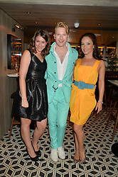 Left to right, BENEDETTA GHIONE, HENRY CONWAY and dancer KATYA VIRSHILAS at Henry Conway's 31st birthday party held at the Pont St Restaurant, Belgraves Hotel, London on 12th July 2014.