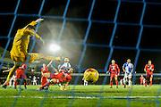 Bristol Rovers forward Matt Taylor scores past York City goalkeeper Scott Flinders  to win the game for Bristol Rovers  during the Sky Bet League 2 match between Bristol Rovers and York City at the Memorial Stadium, Bristol, England on 12 December 2015. Photo by Simon Davies.