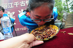 June 25, 2017 - Lijian, Lijian, China - Lijiang, CHINA-June 25 2017: (EDITORIAL USE ONLY. CHINA OUT) ..A participant eats insects at an insect-eating contest in Lijiang, south China's Yunnan Province, June 25th, 2017. A man surname Peng won the contest, eating insects of one kilogram in five minutes. (Credit Image: © SIPA Asia via ZUMA Wire)