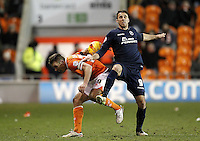 Blackpool's Anthony McMahon battles with  Millwall's Lee Gregory<br /> <br /> Photographer Mick Walker/CameraSport<br /> <br /> Football - The Football League Sky Bet Championship - Blackpool v Millwall - Saturday 10th January 2015 - Bloomfield Road - Blackpool <br /> <br /> © CameraSport - 43 Linden Ave. Countesthorpe. Leicester. England. LE8 5PG - Tel: +44 (0) 116 277 4147 - admin@camerasport.com - www.camerasport.com