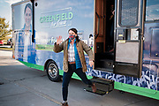 "27 OCTOBER 2020 - MARSHALLTOWN, IOWA: THERESA GREENFIELD steps out of her campaign motorhome during a visit to the UnityPoint Health complex in Marshalltown. Greenfield, the Democratic candidate for US Senate, visited UnityPoint Health - Marshalltown Medical Park in Marshalltown, about 55 miles from Des Moines, and talked to administators and local officials about jobs at the medical center and the need for rural healthcare. It was a part of her ""Jobs That Need to Get Done"" tour and Get Out the Vote efforts before the Nov. 3 election. Greenfield is running against incumbent US Senator Joni Ernst, a Republican.             PHOTO BY JACK KURTZ"