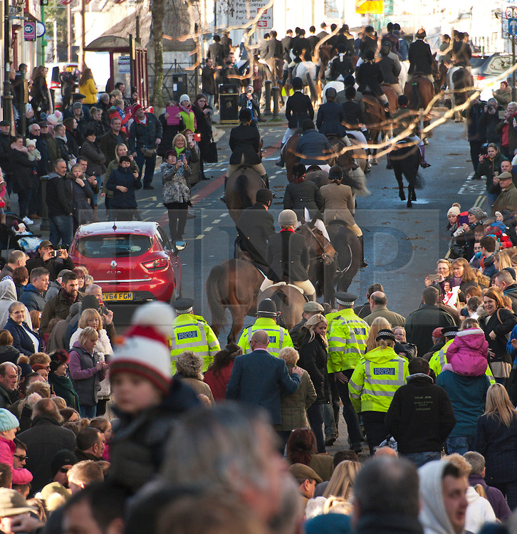 © Licensed to London News Pictures. 02/01/2017. Carmarthen, Carmarthenshire, Wales, UK. Police escort the hunt out of town. Anti-Bloodsport activists gather in the Welsh town of Carmarthen to voice their anger at the continued illegal hunting with dogs - hunting with dogs was made illegal in 2004 by The Hunting Act 2004 (c37). The Anti-Hunt protest takes place on the day that the Carmarthenshire Hunt have chosen to parade through the town to collect money and support for their blood-sports. Photo credit: Graham M. Lawrence/LNP