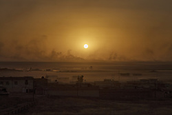 October 20, 2016 - Dohuk, Iraq - The battle of Mosul, day 4.  As the sun goes down, black smoke rises from a Isis controlled village north of Mosul. The Kurdish and Iraqi forces are getting closer to the Isis stronghold every day. The front north of Mosul seen from the city Dohuk, Iraq.  (Credit Image: © Magnus Wennman/Aftonbladet/IBL via ZUMA Wire)