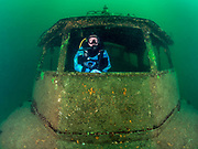 Scuba diver inside the  Silver Comet  at Dutch Springs, Bethlehem
