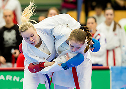 Lina Pusnik of Slovenia (blue) fighting against Team of Serbia (red) during of Kumite Team female at Day Two of Karate 1 World Cup - Thermana Slovenia Lasko 2014 tournament, on March 16, 2014 in Arena Tri Lilije, Lasko, Slovenia.Photo by Vid Ponikvar / Sportida