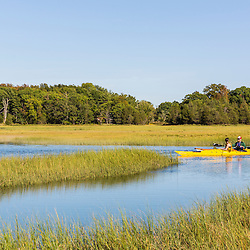 Kayakers on the Essex River at the Cox Reservation in Essex, Massachusetts.