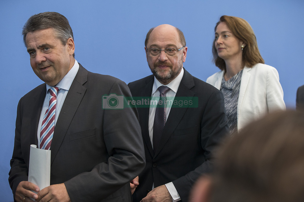 June 27, 2017 - Berlin, Germany - Chancellor Candidate and chairman of the Social Democratic Party (SPD) Martin Schulz (C), Foreign Minister SIgmar Gabriel (L) and Family Minister Katarina Barley (R) leave after a news conference to illustrate the work of the party during the last legislation at Bundespressekonferenz in Berlin, Germany on June 27, 2017. (Credit Image: © Emmanuele Contini/NurPhoto via ZUMA Press)