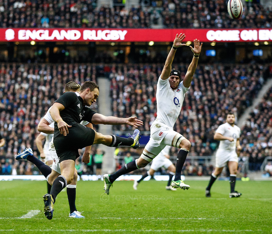 Picture by Andrew Tobin/SLIK images +44 7710 761829. 2nd December 2012. Tom Wood of England tries to charge down a kick by Israel Dagg of New Zealand during the QBE Internationals match between England and the New Zealand All Blacks at Twickenham Stadium, London, England. England won the game 38-21.