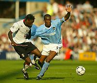 Photo. Aidan Ellis.<br />Fulham v Manchester City.<br />Barclaycard Premiership.<br />20/09/2003.<br />Fulham's Louis Saha and City's Sylvain Distin