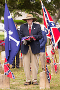 A descendant of Civil War soldiers holds the flag at a ceremony marking Confederate Memorial Day at Magnolia Cemetery April 10, 2014 in Charleston, SC. Confederate Memorial Day honors the approximately 258,000 Confederate soldiers that died in the American Civil War.