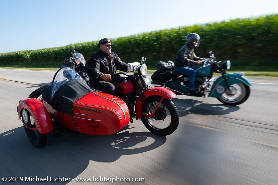 """Erik Dunk, known to everyone simply as Dunk, with his 1937 Harley-Davidson EL during the Joe Ferri on his teal 1947 Indian Chief passes Erik Dunk, known to everyone simply as """"Dunk"""", on his 1937 Harley-Davidson EL with sidecar during the Cross Country Chase motorcycle endurance run from Sault Sainte Marie, MI to Key West, FL (for vintage bikes from 1930-1948). Stage 4 saw a 315 mile ride from Urbana, IL to Bowling Green, KY USA. Monday, September 9, 2019. Photography ©2019 Michael Lichter."""