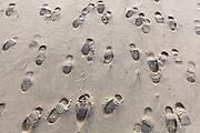 Bootprints in the sand on Bunes Beach, Moskenesoya, Lofoten Islands, Norway.