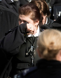 © Licensed to London News Pictures. 22/03/2018. London, UK. An emotional member of the police force during a minutes silence at New Palace Yard, inside the grounds of the Houses of Parliament in Westminster, London at the time PC Palmer died, one year ago today in the Westminster Bridge Terror attack. A lone terrorist killed 5 people and injured several more, in an attack using a car and a knife. The attacker, 52-year-old Briton Khalid Masood, managed to gain entry to the grounds of the Houses of Parliament and killed police officer Keith Palmer. Photo credit: Ben Cawthra/LNP