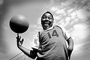 Boy spinning basket ball.