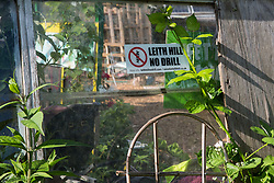 Sipson, UK. 5th June, 2018. A sticker calling for drilling to be prevented at Leith Hill in Surrey is pictured at Grow Heathrow. Grow Heathrow is a squatted off-grid eco-community garden founded in 2010 on a previously derelict site close to Heathrow airport to rally support against government plans for a third runway and it has since made a significant educational and spiritual contribution to life in the Heathrow villages, which remain threatened by Heathrow airport expansion.
