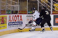 October 13, 2007 - Anchorage, Alaska: Brett Hopfe (15) of the Robert Morris Colonials tries to get past Brock Meadows (3) of the Wayne State Warriors in the Colonials 4-1 victory over the Wayne State Warriors at the Nye Frontier Classic at the Sullivan Arena.