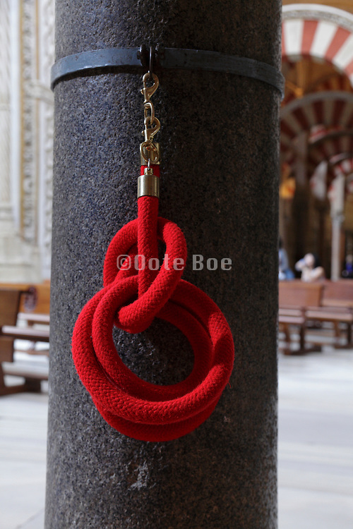 a coiled up red museum rope inside the Mosque - cathedral Cordoba Spain
