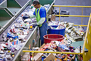 12 MARCH 2007 -- PHOENIX, AZ: ROMAN PINTO sorts recyclable glass bottles at the new recycling center in the city of Phoenix, AZ. The center opened in February 2007 and is the most modern recyclables processing center in the US. The center is operated by Hudson Baylor Corporation and processes about 1000 tonnes of recyclables a week.  Photo by Jack Kurtz/ZUMA Press