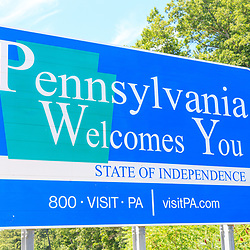Lawrenceville, PA - July 26, 2016: A Pennsylvania Welcomes You sign along I-99 at the NY and Pa border in Tioga County, PA