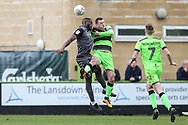 Lincoln City John Akinde(29) and Forest Green Rovers Lee Collins(5) during the EFL Sky Bet League 2 match between Forest Green Rovers and Lincoln City at the New Lawn, Forest Green, United Kingdom on 2 March 2019.