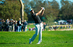 January 27, 2017 - San Diego, CA, USA - Dustin Johnson hits on the 14th hole of the north course of the Torrey Pines Golf Course during the second round of the Farmers Insurance Open on Friday, Jan. 27, 2017. (Credit Image: © K.C. Alfred/San Diego Union-Tribune via ZUMA Wire)