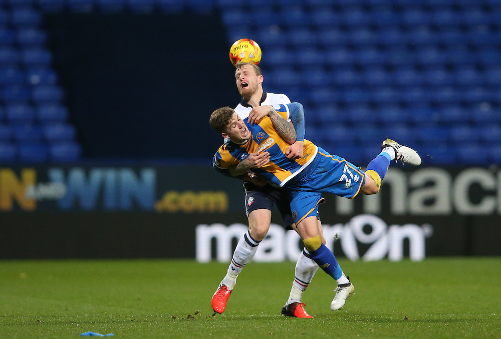 Bolton Wanderers' David Wheater battles with Shrewsbury Town's George Waring<br /> <br /> Photographer Stephen White/CameraSport<br /> <br /> The EFL Sky Bet League One - Bolton Wanderers v Shrewsbury Town - Monday 26th December 2016 - Macron Stadium - Bolton<br /> <br /> World Copyright © 2016 CameraSport. All rights reserved. 43 Linden Ave. Countesthorpe. Leicester. England. LE8 5PG - Tel: +44 (0) 116 277 4147 - admin@camerasport.com - www.camerasport.com