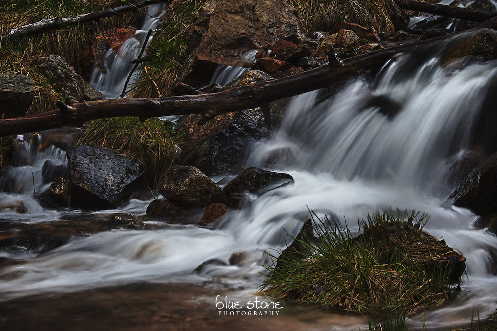 A mountain stream that is fed by melting snow in the spring, with water running through the rocks and logs in a forest.<br /> <br /> Wall art is available in metal, canvas, float wrap and standout. Art prints are available in lustre, glossy, matte and metallic finishes.