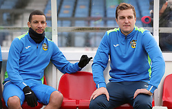 Sutton United's Jamie Collins (right) and Craig Eastmond sit in the dugout during the training session at Gander Green Lane, London.