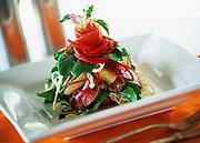 Lamb salad on bed of noodles