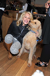 HOLLY PETERSON and her dog Jordan at the 10th anniversary of George in association with The Dog's Trust held at George, 87-88 Mount Street, Mayfair, London on 13th September 2011.