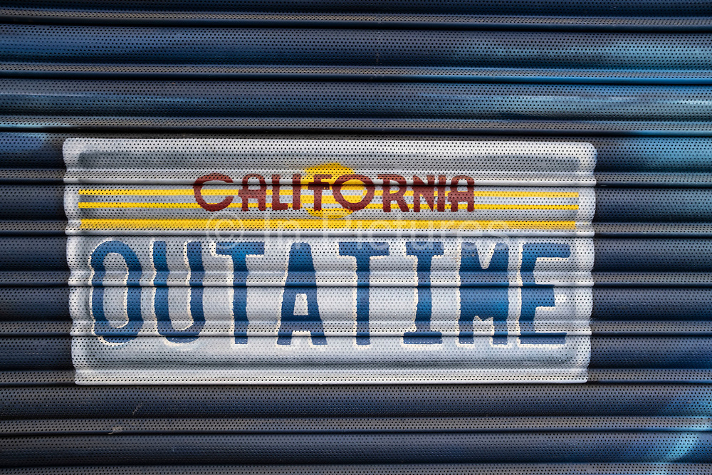 OUTATIME, The worlds most famous movie car number plate from the film Back to the Future, spray painted onto a set of shutters on 15th April 2021 in London, United Kingdom. Back to the Future is a 1985 American science fiction film directed by Robert Zemeckis.