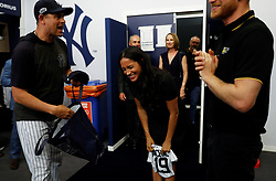 June 29, 2019 - London, London, United Kingdom - Image licensed to i-Images Picture Agency. 29/06/2019. London, United Kingdom. Prince Harry and Meghan Markle, the Duke and  Duchess of Sussex ,receive a present for baby Archie as they meet  players of the New York Yankees before a baseball match against the Boston Red Sox in London  (Credit Image: © Pool/i-Images via ZUMA Press)