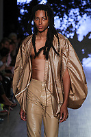 A model walks the runway during threeASFOUR Runway Show hosted by Klarna STYLE360 NYFW on September 11, 2019 in New York City #threeasfour pruduction by @isewhitestylist Makeup: James Vincent @jvincentmakeup casting: @barbarapfister