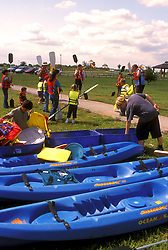 Stock photo of children preparing kayaks for a river adventure