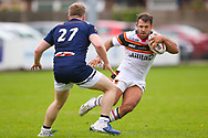 Swinton Lions Liam Carberry (27) is beaten by Bradford Bulls hooker Scott Moore (34) during the Kingstone Press Championship match between Swinton Lions and Bradford Bulls at the Willows, Salford, United Kingdom on 20 August 2017. Photo by Simon Davies.